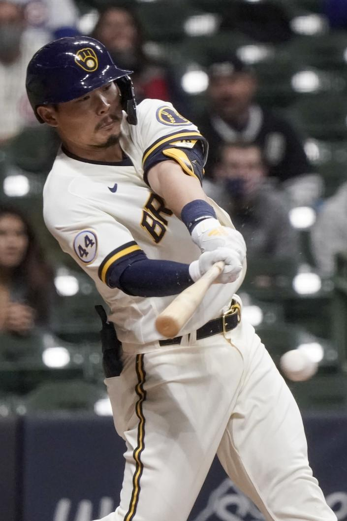 Milwaukee Brewers' Keston Hiura hits an RBI single during the sixth inning of a baseball game against the Chicago Cubs Monday, April 12, 2021, in Milwaukee. (AP Photo/Morry Gash)
