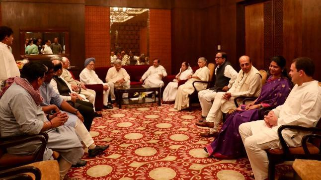 Photos and videos tweeted by the Congress party's official twitter handle show Rahul Gandhi enjoying dinner with former presidents Pratibha Patil and Pranab Mukherjee.