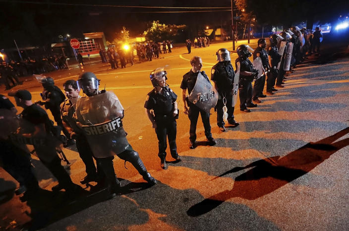Authorities maintain a perimeter around the crime scene after protesters took to the streets of the Frayser community in anger against the shooting a youth by U.S. Marshals earlier in the evening, Wednesday, June 12, 2019, in Memphis, Tenn. Dozens of protesters clashed with authorities, throwing stones and tree limbs until law enforcement personnel broke up the angry crowd with tear gas. (Photo: Jim Weber/Daily Memphian via AP)