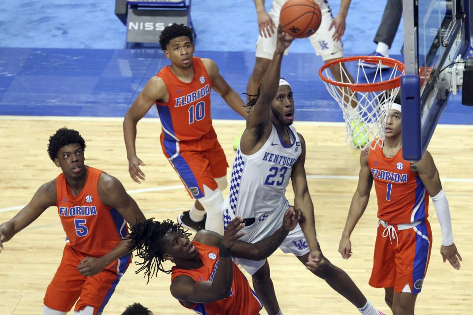 Kentucky's Isaiah Jackson (23) shoots near Florida defenders Omar Payne (5), Anthony Duruji (4),Noah Locke (10) and Tre Mann (1) during the second half of an NCAA college basketball game in Lexington, Ky., Saturday, Feb. 27, 2021. (AP Photo/James Crisp)