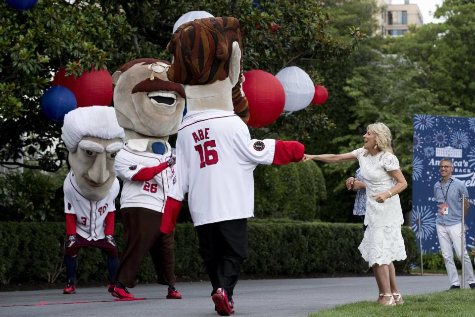 Jill Biden greets the Washington Nationals' presidential mascots on the South Lawn of the White House. - Credit: Michael Reynolds - Pool via CNP / MEGA