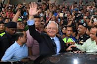 Malaysia's former prime minister Najib Razak, seen here in September 2018, is facing four charges of corruption and three of money-laundering in the case