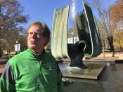 Marshall University athletic director Mike Hamrick speaks next to the Memorial Fountain on the school's campus in Huntington, W.Va., Saturday, Nov. 7, 2020. The fountain is dedicated to the memory of 75 people killed in a Nov. 14, 1970, plane crash. Among the victims were 36 Marshall football players. (AP Photo/John Raby)