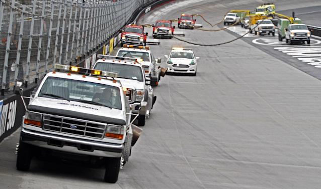 Dryer's make their way around the track prior to the NASCAR Sprint Cup series auto race at Bristol Motor Speedway on Sunday, March 16, 2014, in Bristol, Tenn. (AP Photo/Wade Payne)