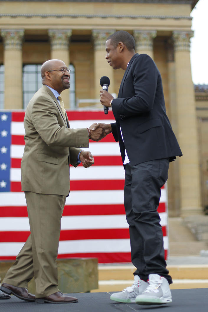 "Entertainer Shawn ""Jay-Z"" Carter, right, shakes hands with Philadelphia Mayor Michael Nutter at the Philadelphia Museum of Art, Monday, May 14, 2012, in Philadelphia. The rapper announced plans for a two-day music festival in Philadelphia's at Fairmount Park, featuring nearly 30 acts ""that embody the American spirit"" on Labor Day weekend, Sept. 1 and Sept. 2, 2012. (AP Photo/Matt Rourke)"