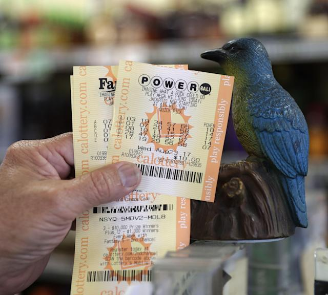 <p>A man shows his Powerball lottery tickets at the Bluebird Liquor store in Hawthorne, Calif., Aug. 23, 2017. (Photo: Mike Nelson/EPA/REX/Shutterstock) </p>