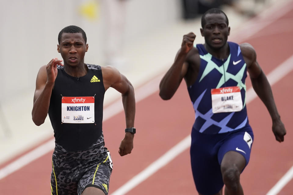 Erriyon Knighton, left, broke a junior record in the 200m that had been set by Usain Bolt in 2003. (AP Photo/Ashley Landis)