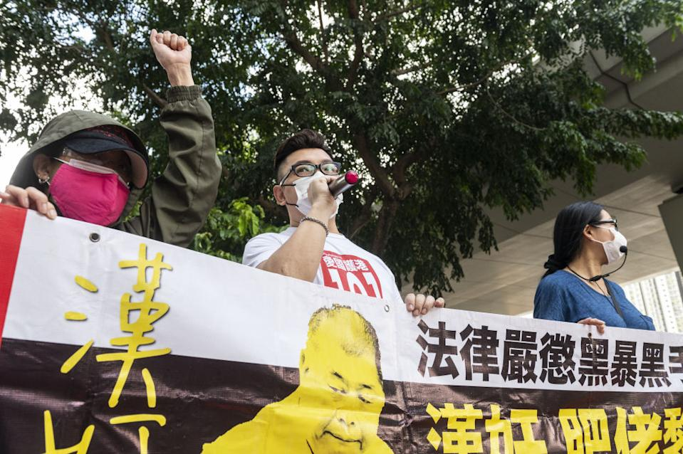 Pro-China supporters demand for Jimmy Lai to be imprisoned as they gather outside the court in Hong Kong, China.