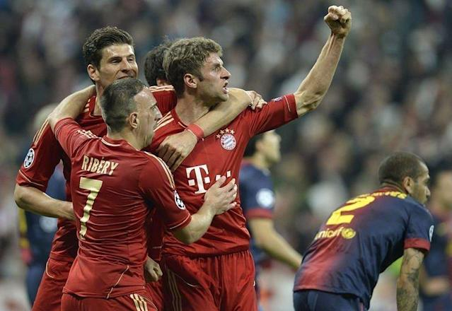 Bayern Munich's midfielder Thomas Mueller (C) celebrates scoring a goal with teammates Mario Gomez (2ndL) and Franck Ribery during their UEFA champions league semi-final first leg football match against Barcelona on April 23, 2013 in Munich, southern Germany. Bayern Munich won 4-0