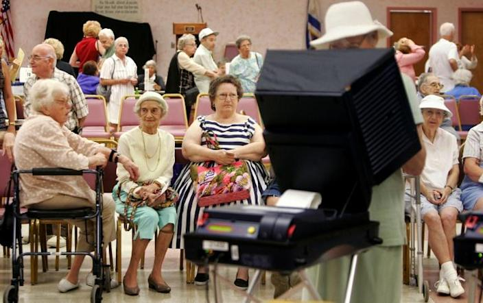 This photo taken November 1, 2004 shows elderly voters -- a historically important voting bloc in Florida -- waiting to cast their ballots at a retirement community in West Palm Beach