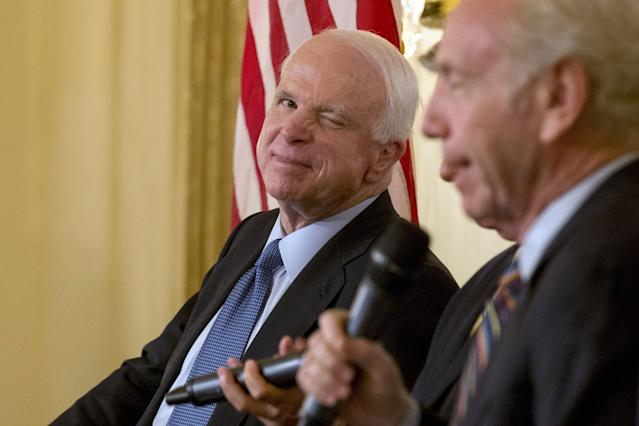 <p>Sen. John McCain winks during a campaign event for Republican presidential candidate Lindsey Graham in New York July 20, 2015. McCain urged Republican presidential candidate Donald Trump to apologize to U.S. military families for saying prisoners of war are not heroes, in his first direct response to Trump's remarks. (Photo: Brendan McDermid/Reuters) </p>