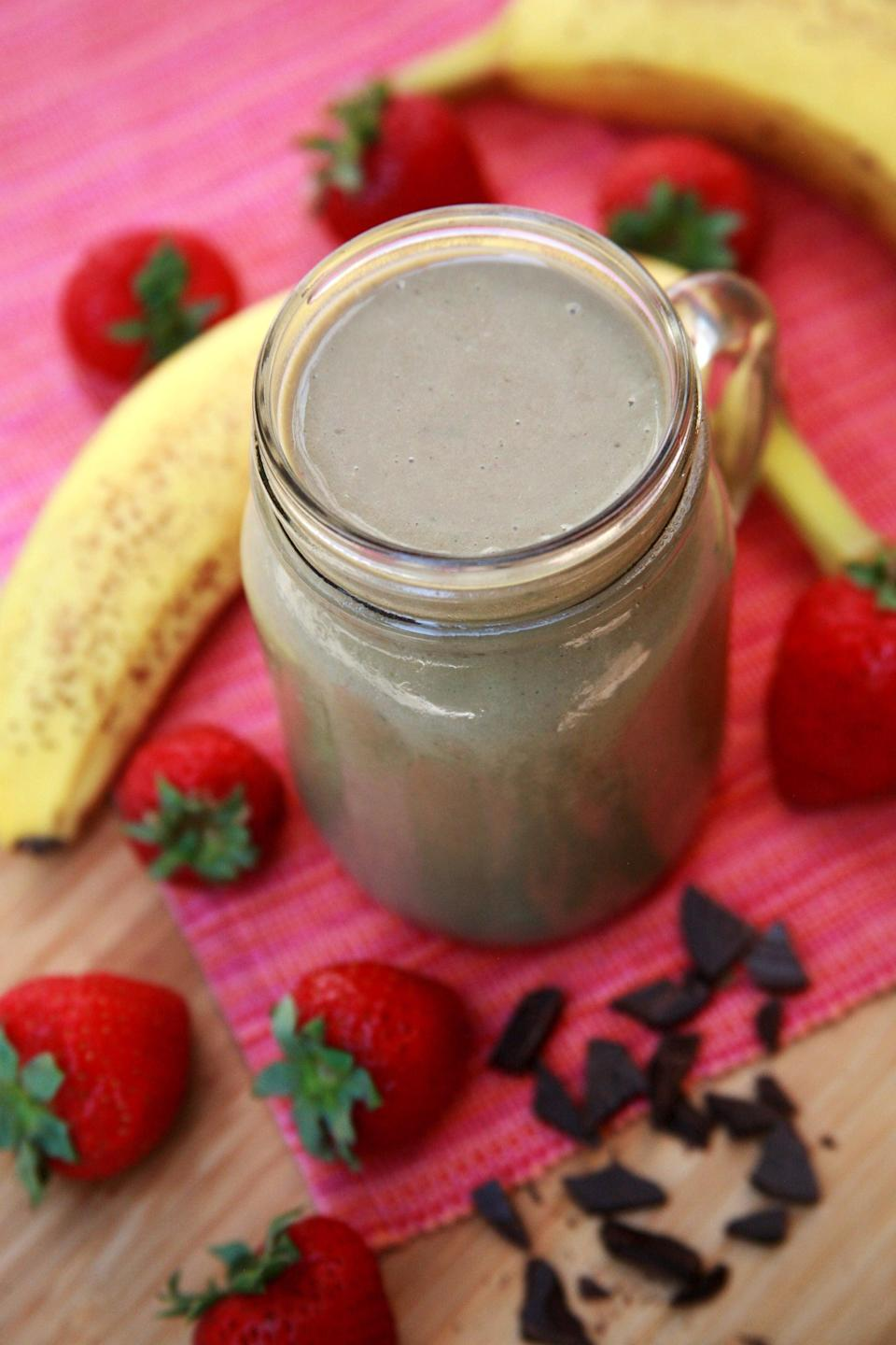 """<p>This classic smoothie made with bananas, strawberries, spinach, peanut butter, chocolate soy milk, and soy yogurt offers almost 15 grams of protein. </p> <p><strong>Get the recipe:</strong> <a href=""""https://www.popsugar.com/fitness/Recipe-Chocolate-Strawberry-Banana-Smoothie-7166332"""" class=""""link rapid-noclick-resp"""" rel=""""nofollow noopener"""" target=""""_blank"""" data-ylk=""""slk:chocolate strawberry banana smoothie"""">chocolate strawberry banana smoothie</a></p>"""