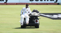 Sri Lanka's Dhananjaya de Silva is driven away after suffering an injury on day one of the first cricket test match between South Africa and Sri Lanka at Super Sport Park Stadium in Pretoria, South Africa, Saturday, Dec. 26, 2020. (AP Photo/Catherine Kotze)