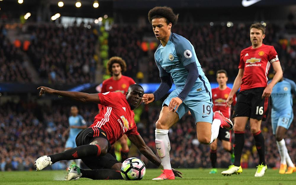 Leroy Sane of Manchester City rides a tackle from Eric Bailly of Manchester United during the Premier League match between Manchester City and Manchester United - Credit: GETTY