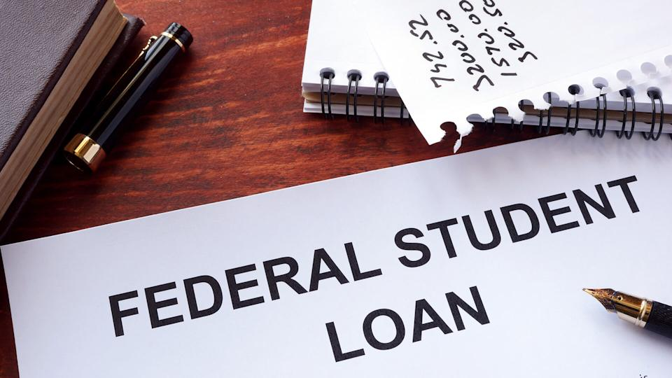 Federal student loan form on a table.