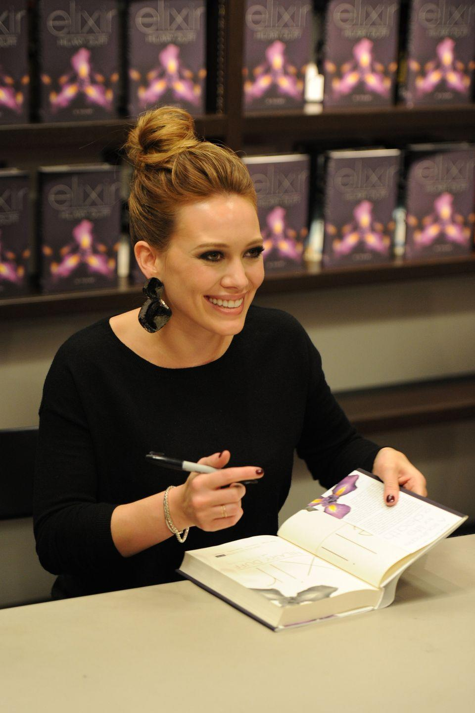 """<p>While Hilary Duff may play a powerhouse editor on <em>Younger</em>, the actress and singer has also proven herself capable on the other side of the table as well. The <em>Lizzie McGuire</em> star released her first young adult novel, <em>Elixir</em>, in October 2010. </p><p>The book centers on Clea Raymond, a talented photojournalist whose life starts to unravel after her father's disappearance and the appearance of a mysterious stranger, Sage, who might be the only one who can help her. </p><p>""""I've always loved the escape of a great book, especially one that features a strong, inspiring female character you feel you really understand,"""" Hilary told <em><a href=""""https://ew.com/article/2010/03/09/hilary-duff-to-write-a-ya-series/"""" rel=""""nofollow noopener"""" target=""""_blank"""" data-ylk=""""slk:Entertainment Weekly"""" class=""""link rapid-noclick-resp"""">Entertainment Weekly</a></em> at the time of <em>Elixir</em>'s release. The story of Clea and Sage continues in two more books in the series, <em>Devoted</em> and <em>True</em>.</p><p><a class=""""link rapid-noclick-resp"""" href=""""https://www.amazon.com/Elixir-Hilary-Duff/dp/1442408545?tag=syn-yahoo-20&ascsubtag=%5Bartid%7C2140.g.33987725%5Bsrc%7Cyahoo-us"""" rel=""""nofollow noopener"""" target=""""_blank"""" data-ylk=""""slk:Buy the Book"""">Buy the Book</a></p>"""