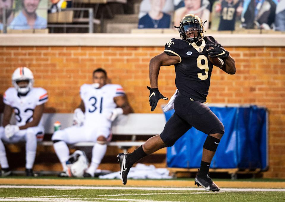 Wake Forest sophomore running back Kenneth Walker III (9) looks for pursuit as he runs the ball on his way to a touchdown on Saturday, Oct. 17, 2020 at Truist Field in Winston-Salem, N.C. (Winston-Salem Journal/Andrew Dye) 101820-wsj-spt-wakefootball