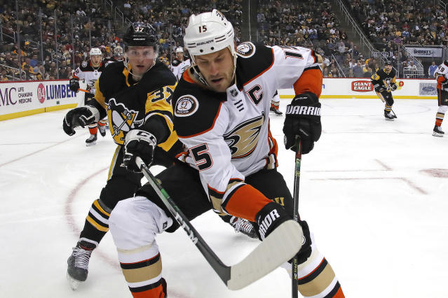 Anaheim Ducks' Ryan Getzlaf (15) goes after the puck in the corner with Pittsburgh Penguins' Sam Lafferty (37) during the second period of an NHL hockey game in Pittsburgh, Thursday, Oct. 10, 2019. (AP Photo/Gene J. Puskar)