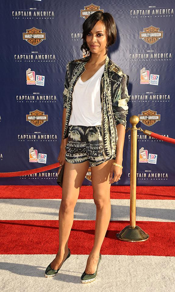 """Meanwhile, at the """"Captain America"""" premiere, """"Avatar"""" star Zoe Saldana opted for a semi-casual outfit. What do you think of her Balmain blazer-shorts combo and those stunning, studded Brian Atwood """"Pois"""" pumps? In my opinion, this laid-back look is super stylish. Jason LaVeris/<a href=""""http://www.filmmagic.com/"""" target=""""new"""">FilmMagic.com</a> - July 19, 2011"""