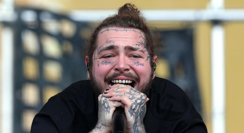 Post Malone has been the true face (get it?) of tattoos above the neck. (Photo by Simone Joyner/Getty Images)