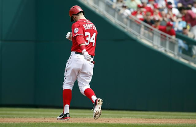 Washington Nationals' Bryce Harper turns around between first and second after flying out to right field during the third inning of a baseball game against the St. Louis Cardinals at Nationals Park Saturday, April 19, 2014, in Washington. Harper was pulled early from a game after Washington manager Matt Williams said the young outfielder didn't hustle. Harper was taken out after six innings The 21-year-old Harper is a two-time All-Star known for his aggressive play. But in the sixth inning, he hit the ball to the mound, jogged to first and took a right turn to the dugout before getting halfway down the basepath. The Cardinals won 4-3. (AP Photo/Alex Brandon)