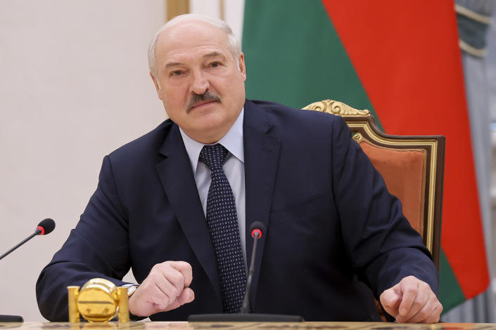 """FILE - In this May 28, 2021, file photo, Belarus President Alexander Lukashenko addresses prime ministers from countries that were once part of the former Soviet Union at a meeting, in Minsk, Belarus. Dissident journalist Raman Pratasevich arrested when Belarus diverted his flight has said in a video released Wednesday June 2, 2021, from prison that he has been set up by an unidentified associate. Lukashenko, who has ruled the ex-Soviet nation of 9.3 million with an iron fist for more than a quarter-century, has accused the West of trying to """"strangle"""" his country with sanctions.(Sergei Sheleg/BelTA Pool Photo via AP, File)"""