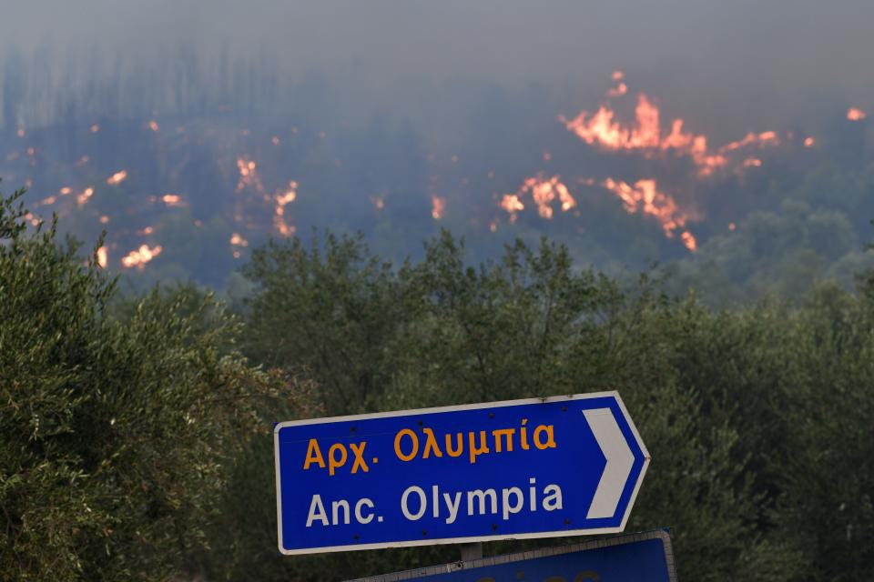A wildfire approaches the ancient Olympia on Wednesday. Source: Giannis Spyrounis/AP