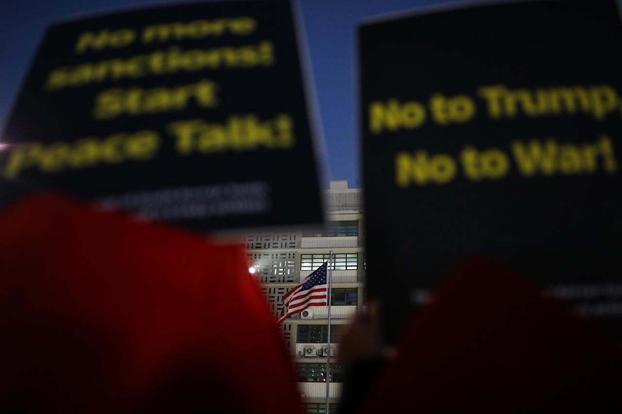 <p>Demonstrators hold placards near an American flag during a protest ahead of President Donald Trump's visit outside the U.S. Embassy in Seoul, South Korea, on Saturday, Nov. 4, 2017. (Photo: Seong Joon Cho/Bloomberg via Getty Images) </p>