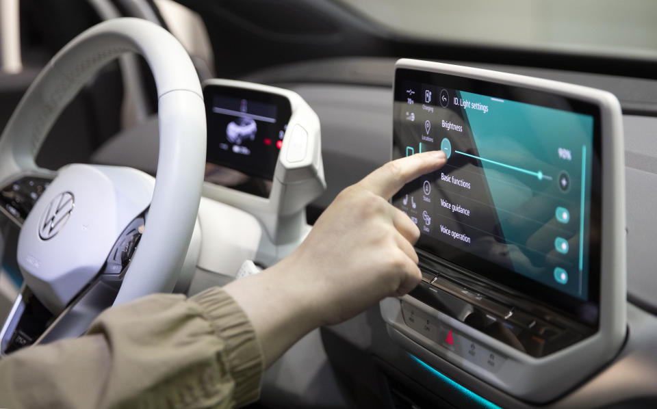 THOUSAND OAKS, CA - JANUARY 19: A man tests the new touchscreen inside the new all-electric Volkswagen ID.4 that is on display inside a dealership on January 19, 2021 in Thousand Oaks, California. (Photo by Josh Lefkowitz/Getty Images)