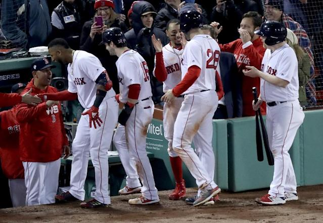 Boston's Eduardo Nunez is congratulated by his Red Sox teammates after a three-run homer in their 8-4 World Series victory Tuesday over the Los Angeles Dodgers (AFP Photo/Rob Carr)