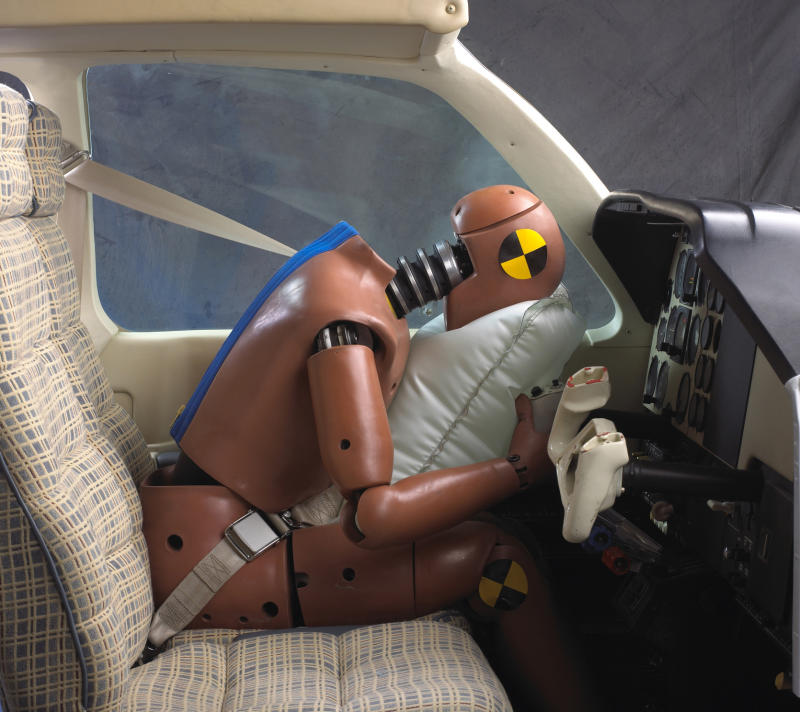 This image provided by AmSafe Inc., demonstrates an aviation airbag using a crash dummy. The airbags are located on the shoulder harness and deploy on impact. The National Transportation Safety Board is set to release a study on Tuesday, Jan. 11, 2011, of 138 accidents involving planes equipped with air bags. (AP Photo/AmSafe Inc.)