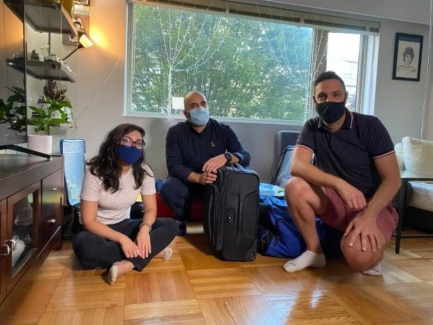 From left, Julnar Doueik, Charbel Elia and Patrick Rmeily will fly to Beirut later this week, carrying six suitcases filled with medications and essential supplies that have become near impossible to find in Lebanon. (Michelle Ghoussoub/CBC - image credit)