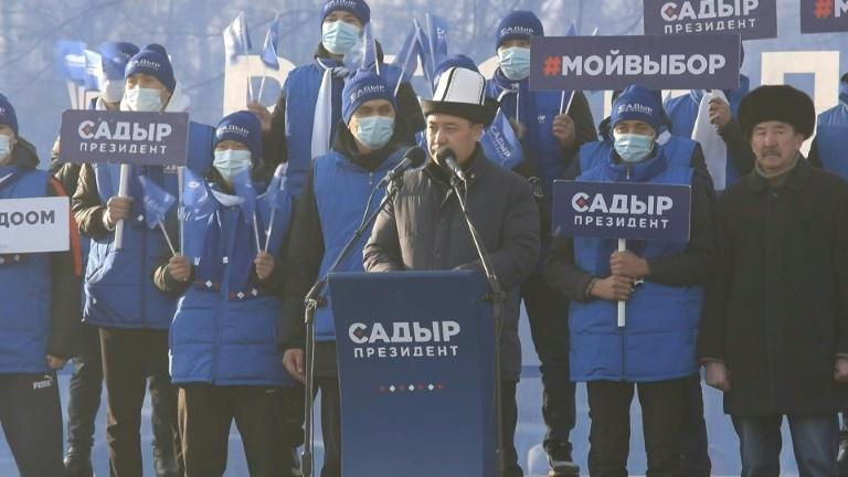 Frontrunner Japarov greets supporters at a campaign rally, three months after he languished in jail, mourning his parents and a son who all died whilst he was imprisoned