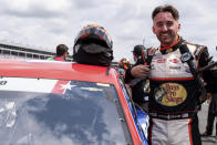 Austin Dillon stands by his car during qualifying for the NASCAR Cup Series auto race at Charlotte Motor Speedway on Saturday, May 29, 2021 in Charlotte, N.C. (AP Photo/Ben Gray)