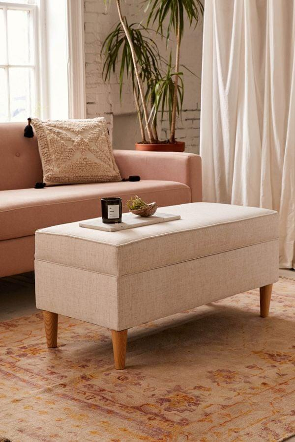 "<p>No one will ever guess that this <a href=""https://www.popsugar.com/buy/Raquel-Linen-Storage-Ottoman-543185?p_name=%20Raquel%20Linen%20Storage%20Ottoman&retailer=urbanoutfitters.com&pid=543185&price=329&evar1=casa%3Aus&evar9=47140357&evar98=https%3A%2F%2Fwww.popsugar.com%2Fhome%2Fphoto-gallery%2F47140357%2Fimage%2F47140376%2FRaquel-Linen-Storage-Ottoman&list1=shopping%2Curban%20outfitters%2Cfurniture%2Csmall%20space%20living%2Chome%20shopping&prop13=api&pdata=1"" rel=""nofollow"" data-shoppable-link=""1"" target=""_blank"" class=""ga-track"" data-ga-category=""Related"" data-ga-label=""https://www.urbanoutfitters.com/shop/raquel-linen-storage-ottoman?category=furniture&amp;color=010&amp;type=REGULAR"" data-ga-action=""In-Line Links""> Raquel Linen Storage Ottoman </a> ($329) also has storage space.</p>"