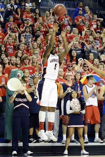 Gonzaga's Gary Bell Jr., (5) shoots a 3-pointer against South Dakota in the first half of an NCAA college basketball game, Sunday, Nov. 18, 2012, in Spokane, Wash. (AP Photo/Jed Conklin)