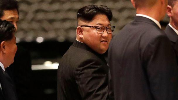 PHOTO: North Korean leader Kim Jong Un walks out from the Marina Bay Sands hotel during a city tour in Singapore, June 11, 2018. (Mast Irham/EPA-EFE via REX/Shutterstock)