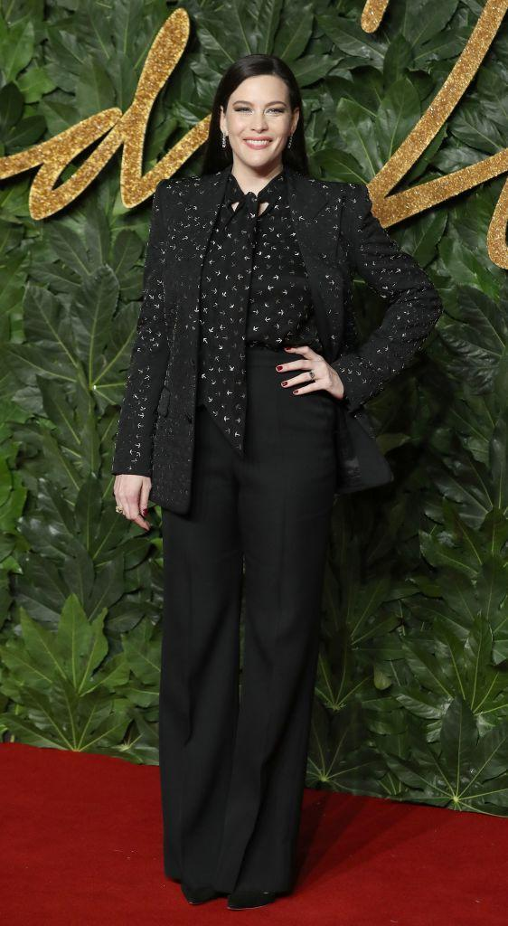 <p>Proving the suit can work wonders on the red carpet, Liv Tyler chose a minimal co-ord with glitzy earrings to finish. A winning sartorial recipe every time. <em>[Photo: Getty]</em> </p>