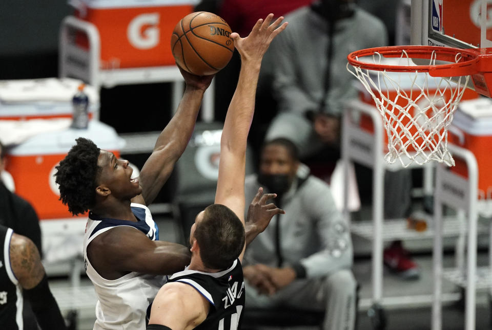 Minnesota Timberwolves rookie forward Anthony Edwards, left, shoots as Los Angeles Clippers center Ivica Zubac defends during the first half of their game on April 18, 2021, in Los Angeles. (AP Photo/Mark J. Terrill)