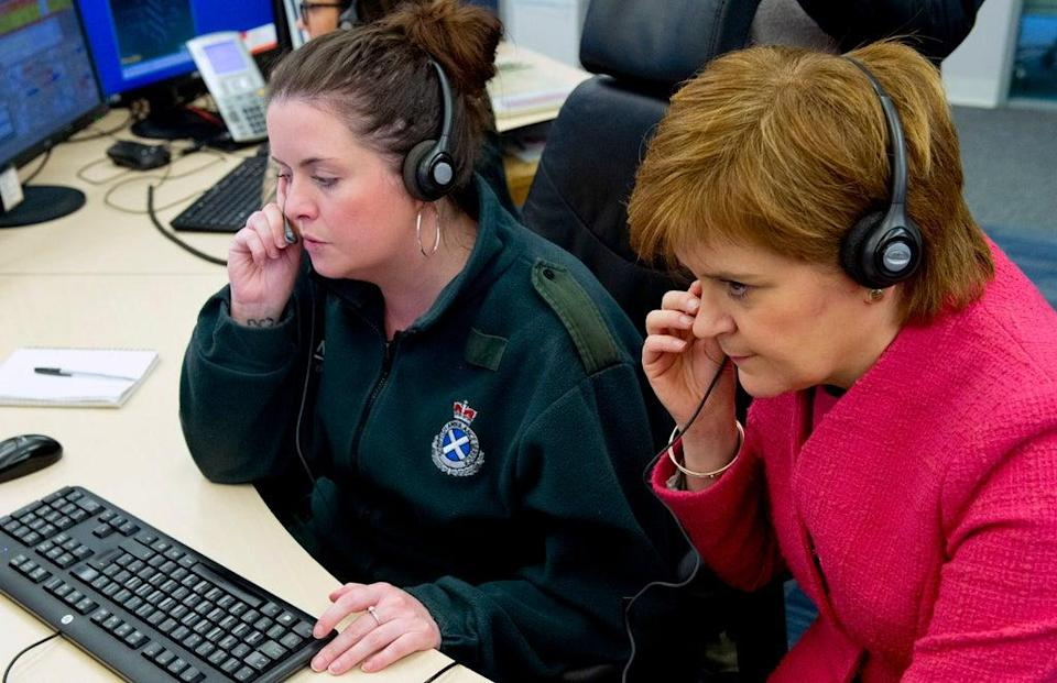 First Minister Nicola Sturgeon listens into a 999 call during a previous tour of a Scottish Ambulance Service call centre (Garry F McHarg/Daily Record/PA) (PA Archive)