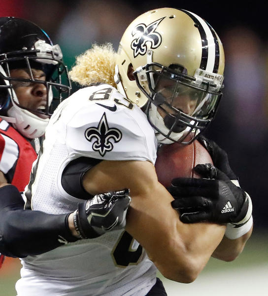 FILE - In this Jan. 1, 2017, file photo, Atlanta Falcons cornerback Deji Olatoye, obscured at left, tackles New Orleans Saints wide receiver Willie Snead (83) during the second half of an NFL football game, in Atlanta. Snead has bid farewell to the Saints, which means New Orleans apparently won't match the contract the Baltimore Ravens offered the restricted free agent. Eager to add a target for quarterback Joe Flacco, the Ravens on Friday offered Snead a two-year, $10.4 million contract. The Saints had five days to match the deal. Snead indicated Monday, April 23, 2018, on Twitter that he's headed out of New Orleans. (AP Photo/John Bazemore, File)