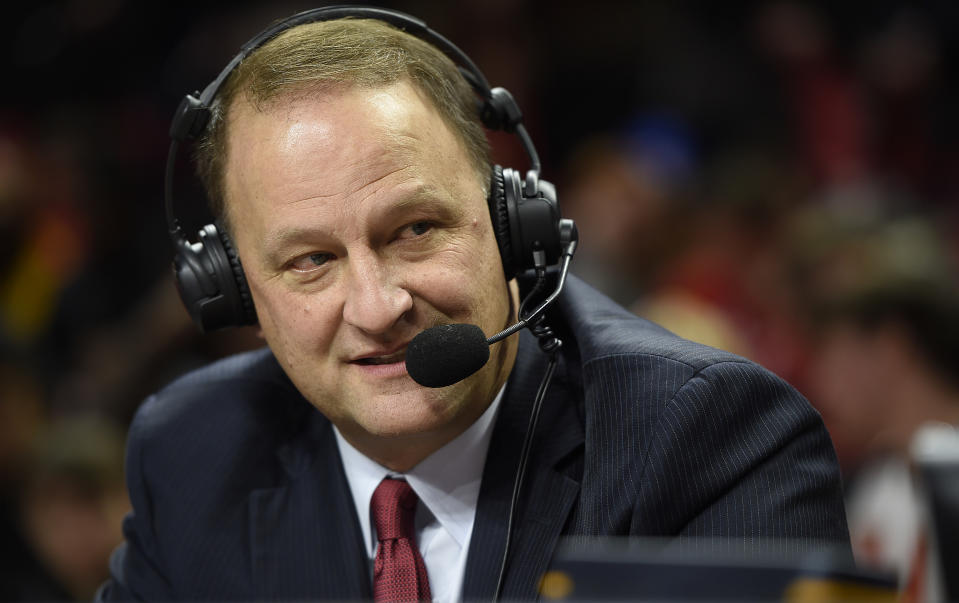 ESPN analysts Dan Dakich awaits the start of the Maryland and Indiana NCAA college basketball game, Tuesday, Jan. 10, 2017 in College Park, Md. (AP Photo/Gail Burton)