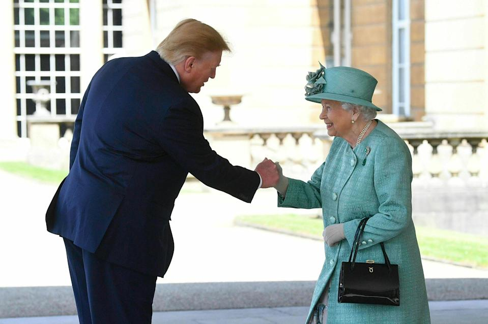 Britain's Queen Elizabeth II greets President Donald Trump as he arrives for a welcome ceremony in the garden of Buckingham Palace, in London, Monday, June 3, 2019, on the first day of a three day state visit to Britain. (Photo: Victoria Jones/Pool via AP)