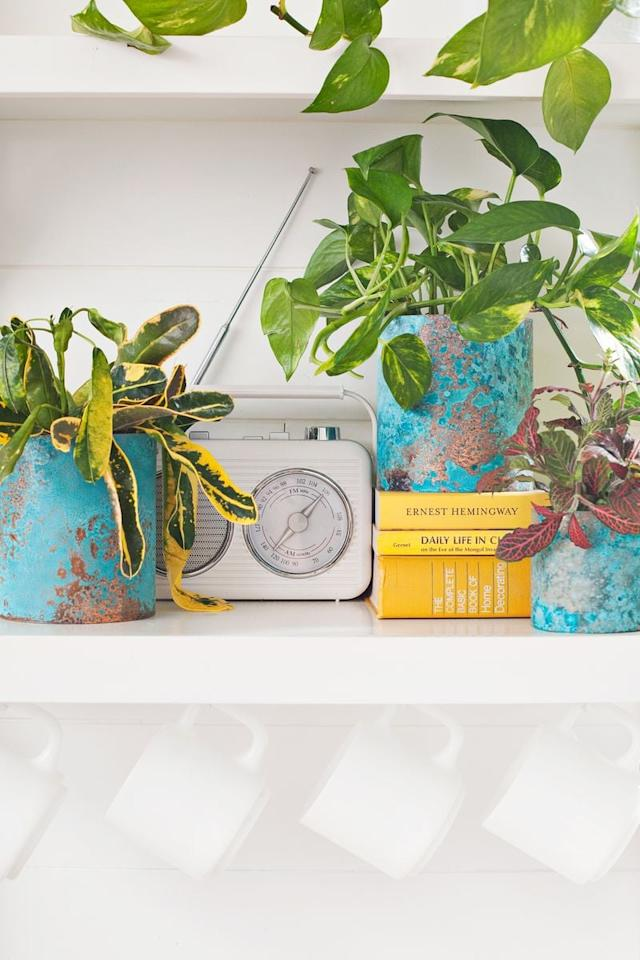 """<p>Turn old paint cans into chic planters for flowers, hanging plants, or even herbs by using <product href=""""https://abeautifulmess.com/2016/03/upcycled-oxidized-copper-planters.html"""" target=""""_blank"""" class=""""ga-track"""" data-ga-category=""""Related"""" data-ga-label=""""https://abeautifulmess.com/2016/03/upcycled-oxidized-copper-planters.html"""" data-ga-action=""""In-Line Links"""">oxidized copper planters</product>.</p>"""