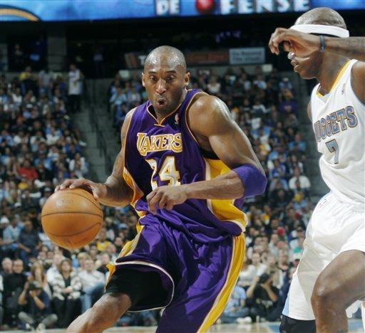 Los Angeles Lakers guard Kobe Bryant, left, works the ball inside for a shot past Denver Nuggets forward Al Harrington in the first quarter of Game 4 of the teams' first-round NBA basketball series in Denver on Sunday, May 6, 2012. (AP Photo/David Zalubowski)