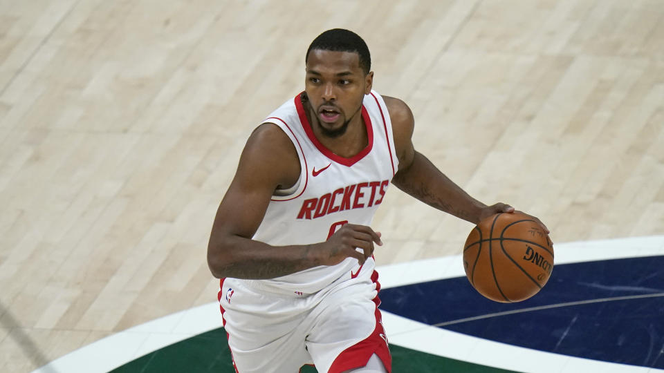 Houston Rockets guard Sterling Brown (0) brings the ball up court in the second half during an NBA basketball game against the Utah Jazz Friday, March 12, 2021, in Salt Lake City. (AP Photo/Rick Bowmer)