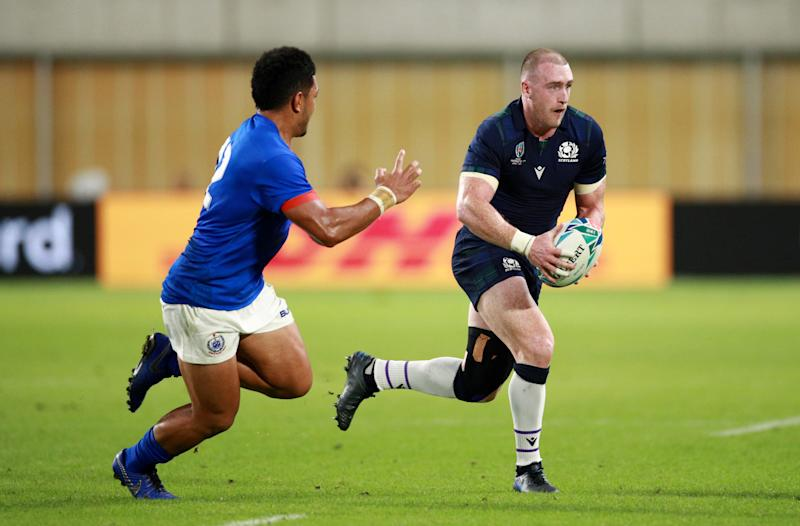 KOBE, JAPAN - SEPTEMBER 30: Stuart Hogg of Scotland (R) runs with the ball during the Rugby World Cup 2019 Group A game between Scotland and Samoa at Kobe Misaki Stadium on September 30, 2019 in Kobe, Hyogo, Japan. (Photo by Adam Pretty/Getty Images)