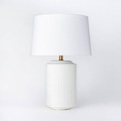 """<p><strong>Threshold x Studio McGee</strong></p><p>target.com</p><p><strong>$69.00</strong></p><p><a href=""""https://www.target.com/p/ceramic-assembled-table-lamp-white-threshold-designed-with-studio-mcgee/-/A-79802545"""" rel=""""nofollow noopener"""" target=""""_blank"""" data-ylk=""""slk:BUY NOW"""" class=""""link rapid-noclick-resp"""">BUY NOW</a></p><p>The body of this table lamp features a textured ceramic. Great for nightstands, end tables, and accent tables, this lamp has dimmable setting that you can change to fit your mood. </p>"""