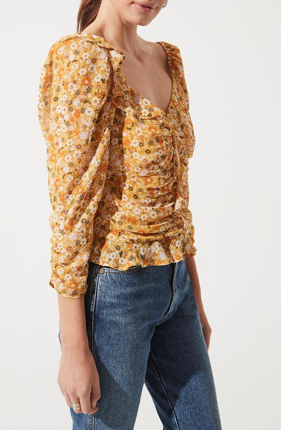 <p>You can easily dress this <span>ASTR the Label Ruched Sleeve Blouse</span> ($33, originally $55) down with jeans, or up with sleek trousers.</p>