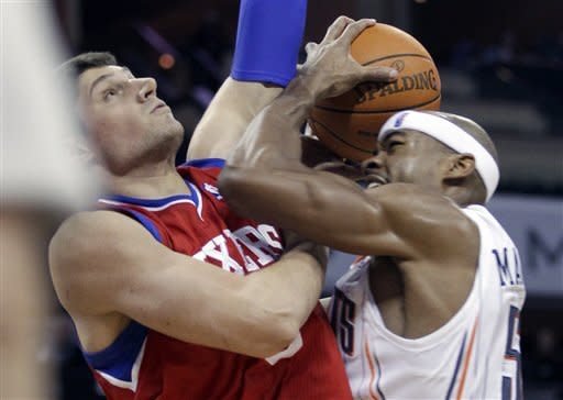 Charlotte Bobcats' Corey Maggette, right, is fouled by Philadelphia 76ers' Nikola Vucevic during the first half of an NBA basketball game in Charlotte, N.C., Monday, Feb. 13, 2012. (AP Photo/Chuck Burton)
